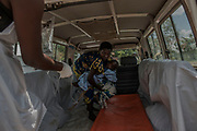 KYANGWALI REFUGEE CAMP, UGANDA - MARCH 23: Rene Ngabusi carries her 14 month old son Solomon Longiringaat out of an ambulance at a cholera treatment center in Kyangwali refugee resettlement camp in Uganda on March 23, 2018. Cholera is endemic in Eastern Congo and many of the refugees bring the disease to the camp. Violence in Ituri Province in northeastern Democratic Republic of Congo has displaced more than 100,000 people including approximately 40,000 refugees who have fled to Uganda. (Photo by Andrew Renneisen for The Washington Post)