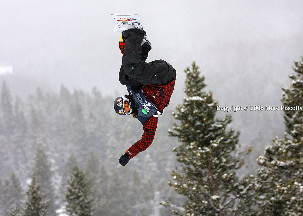 12/20/08 2:51:36 PM -- Breckenridge, CO, U.S.A. -- Snowboarder Shaun White of Carlsbad, Ca. gets inverted high above the superpipe at the inaugural Winter Dew Tour in Breckenridge, Co. on December 20, 2008. White, who has been dominating just about any contest he enters, finished second in the event with a score of 93. The four-day competition is the first of three stops on the tour that features freeskiing and snowboarding..(Photo by Marc Piscotty / © 2008)