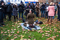 London, December 12th 2014. Porn and sex workers gather outside the Houses of Parliament for a mass sex simulation and face-sitting event in rotest against newly outlawed sex acts in the making of pornography in the UK. Under new Audiovisual Media Services Regulations 2014 rules, such acts as facesitting, spanking and female ejaculation are, among others, now banned from being shown  porn watched online. PICTURED: A woman in riding gear face-sits a similarly dressed man as the media crowds round.