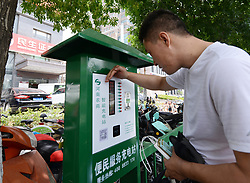 May 24, 2017 - Zhengzh, Zhengzh, China - Zhengzhou, CHINA-May 24 2017: (EDITORIAL USE ONLY. CHINA OUT) Fifty electric bike charging stations are set on street in Zhengzhou, central China's Henan Province, May 24th, 2017. It costs only 0.25 yuan to charge electric bike per hour. (Credit Image: © SIPA Asia via ZUMA Wire)