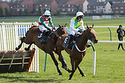 THEATRE LEGEND (3) ridden by Sean Quinlan and trained by Chris Grant jumps the last fence behind long time leader Champagne Mystery before winning The Remus Uomo Handicap Hurdle Race over 2m (£16,800)  during the Scottish Grand National, Ladies day at Ayr Racecourse, Ayr, Scotland on 12 April 2019.