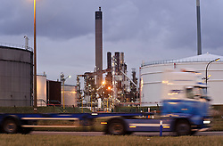 An empty lorry passes by the Petroplus Holdings AG oil refinery, at the Port of Antwerp, in Antwerp, Belgium, Friday, Jan. 6, 2012. (Photo © Jock Fistick)