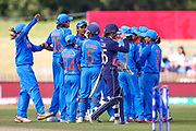 India celebrate as England womens cricket Fran Wilson walks off after being run out during the ICC Women's World Cup match between England and India at the 3aaa County Ground, Derby, United Kingdom on 24 June 2017. Photo by Simon Davies.