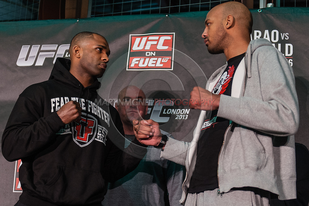 LONDON, ENGLAND, FEBRUARY 13, 2013: Jimi Manuwa and Cyrille Dibate face off after the pre-fight press conference for UFC on Fuel TV 7 inside London Shootfighters Gym in Park Royal, London, England on Wednesday, February 13, 2013 © Martin McNeil