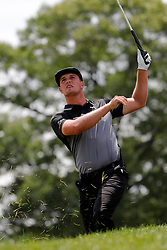 June 22, 2018 - Cromwell, CT, U.S. - CROMWELL, CT - JUNE 22: Bryson DeChambeau of the United States hits his approach shot on the 18th hole during the Second Round of the Travelers Championship on June 22, 2018, at TPC River Highlands in Cromwell, Connecticut. (Photo by Fred Kfoury III/Icon Sportswire) (Credit Image: © Fred Kfoury Iii/Icon SMI via ZUMA Press)