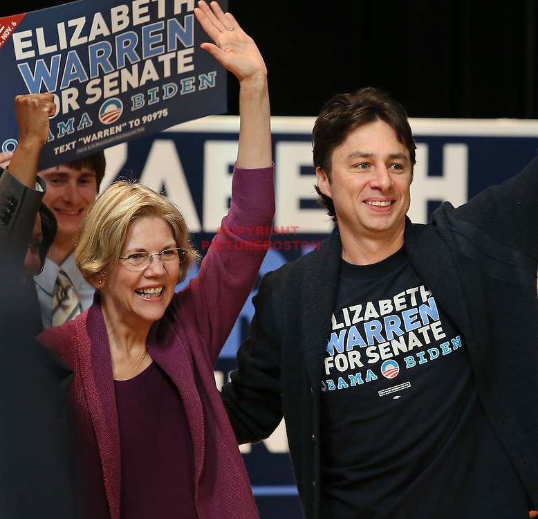 U.S Senate candidate Elizabeth Warren, flanked by actor Zach Braff, is warmly greeted at Northeastern University this morning, October 13, 2012, at a campaign rally.
