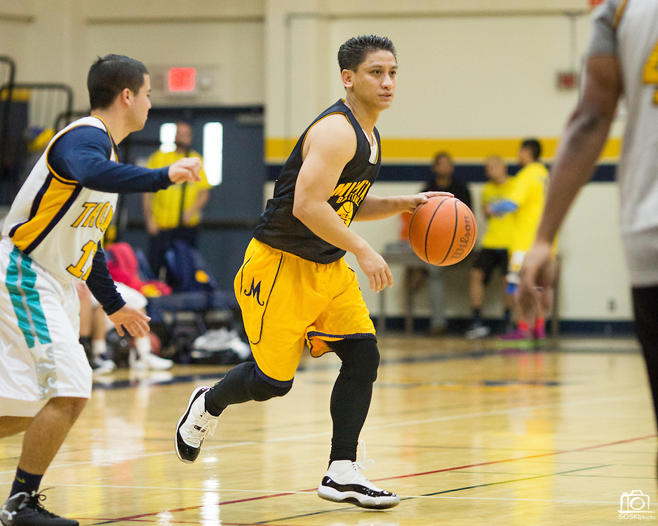 Class of 1996 alumni Eddy Ramos dribbles the ball during the Milpitas High School Alumni Basketball Tournament consolation championship game at Milpitas High School in Milpitas, California, on January 3, 2015. (Stan Olszewski/SOSKIphoto)