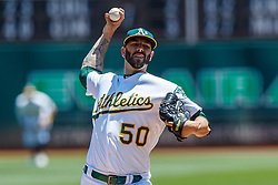OAKLAND, CA - JULY 28:  Mike Fiers #50 of the Oakland Athletics pitches against the Texas Rangers during the first inning at the RingCentral Coliseum on July 28, 2019 in Oakland, California. (Photo by Jason O. Watson/Getty Images) *** Local Caption *** Mike Fiers