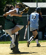 Cornwall pitcher Kristen Halvorsen, center, celebrates with catcher Caity Flanagan after retiring Becky Hafele, right, of Saugerties for the final out in the Section 9 championship game at Minisink Valley. tbthr  SOFTBALL CELEBRATION..