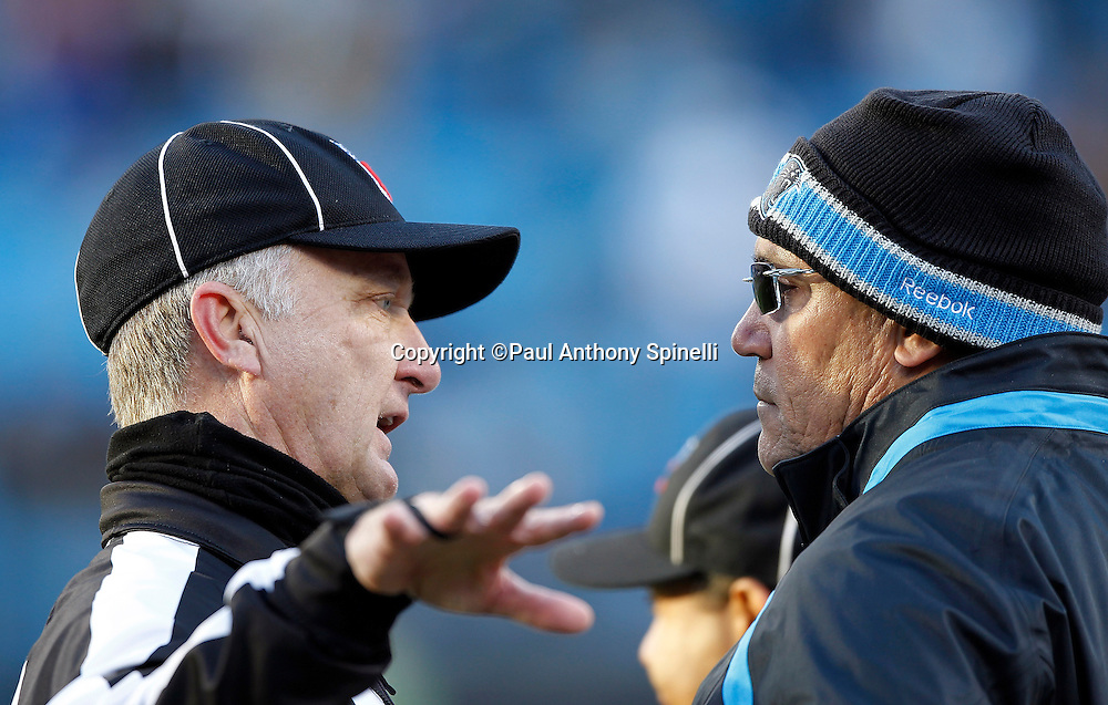 Carolina Panthers head coach Ron Rivera talks to an NFL official during the NFL week 14 football game against the Atlanta Falcons on Sunday, December 11, 2011 in Charlotte, North Carolina. The Falcons won the game 31-23. ©Paul Anthony Spinelli