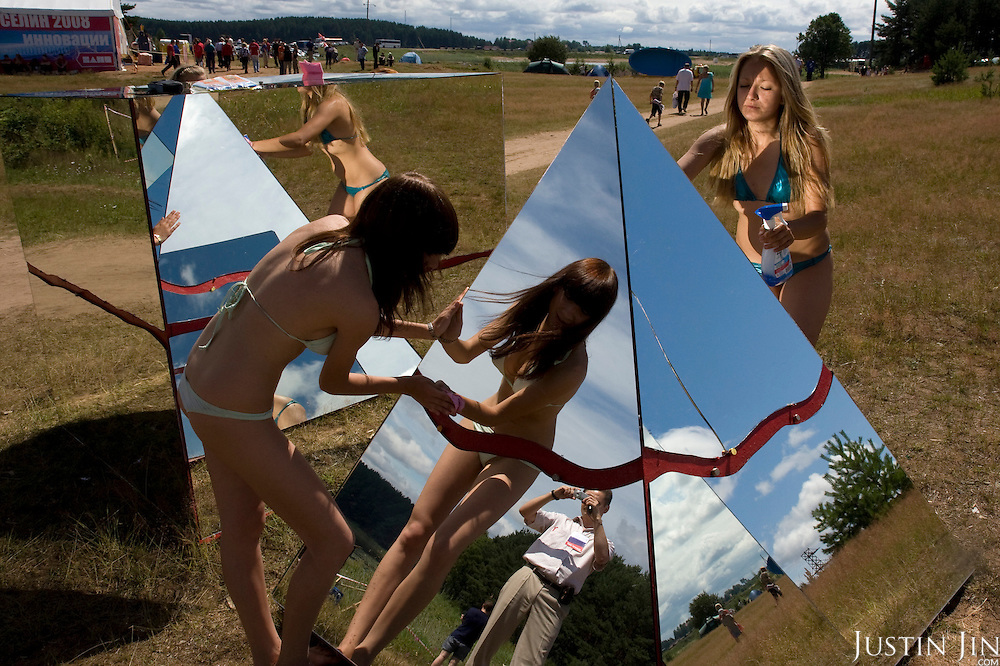 Pro-Putin Nashi youths cleans a pyramid symbolising Nashi in a summer camp on Lake Seliger in Russia. The yearly camp, organised by the nationalistic group, trains youth in political activism.
