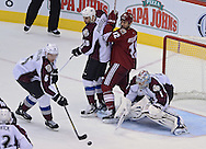 Apr. 6, 2013; Glendale, AZ, USA; Colorado Avalanche defenseman Erik Johnson (6) clears the puck from the goal box as goalie Semyon Varlamov (1)  defends the goal in the third period against the Phoenix Coyotes at Jobing.com Arena. The Coyotes defeated the Avalanche 4-0.  Mandatory Credit: Jennifer Stewart-USA TODAY Sports
