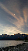Sunset falls over the mountains of Fiordland National Park and Lake Te Anau; Te Anau, Southland, New Zealand