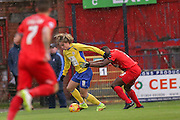 Accrington Stanley midfielder Josh Windass  holds off York City defender Femi Illesami  during the Sky Bet League 2 match between York City and Accrington Stanley at Bootham Crescent, York, England on 28 November 2015. Photo by Simon Davies.