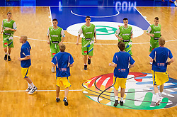 Players at warming up prior to the basketball match between National teams of Sweden and Slovenia in First Round of U20 Men European Championship Slovenia 2012, on July 13, 2012 in Domzale, Slovenia. (Photo by Vid Ponikvar / Sportida.com)
