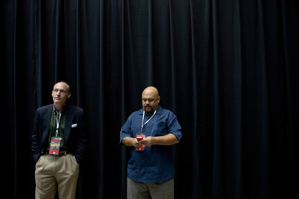 Republican presidential hopeful Thaddeus McCotter, left, watches the conclusion of the Republican presidential debate, in which he did not qualify to participate, from the media area on Thursday, August 11, 2011 in Ames, IA.