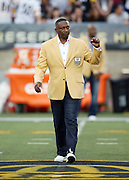 Former Los Angeles Raiders wide receiver Tim Brown waves to fans as he is introduced as a newly enshrined member of the NFL Pro Football Hall of Fame before the Pittsburgh Steelers 2015 NFL Pro Football Hall of Fame preseason football game against the Minnesota Vikings on Sunday, Aug. 9, 2015 in Canton, Ohio. The Vikings won the game 14-3. (©Paul Anthony Spinelli)