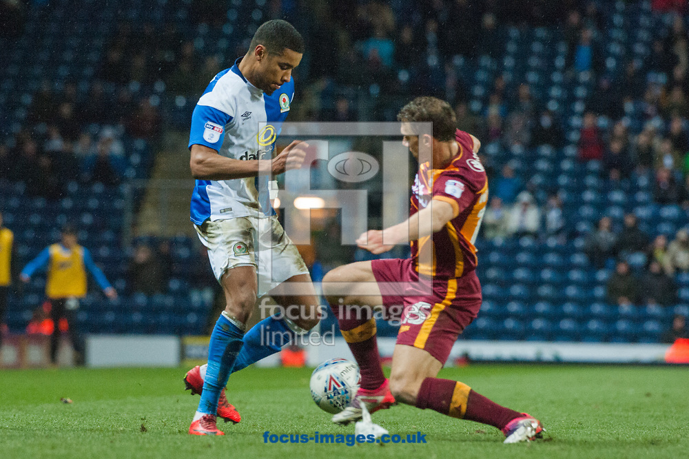 Stephen Warnock of Bradford City attempts to tackle Dominic Samuel of Blackburn Rovers during the Sky Bet League 1 match at Ewood Park, Blackburn<br /> Picture by Matt Wilkinson/Focus Images Ltd 07814 960751<br /> 29/03/2018