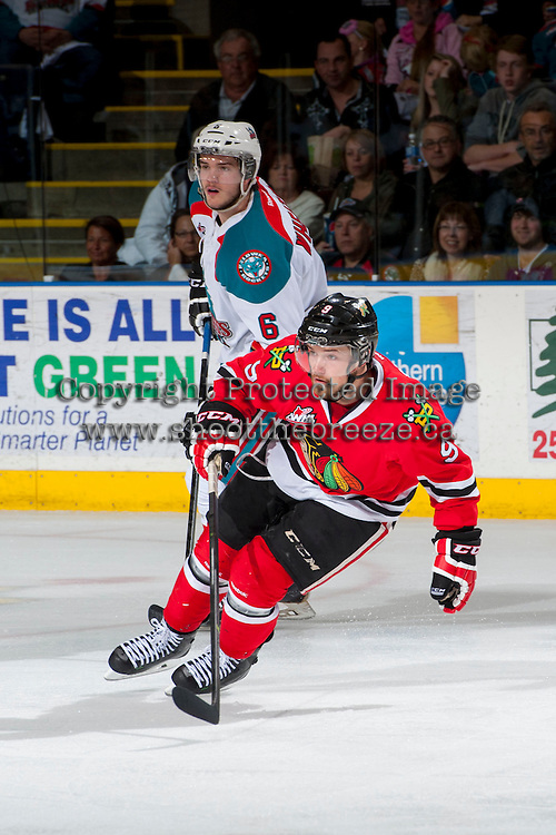 KELOWNA, CANADA - APRIL 18: Mitchell Wheaton #6 of the Kelowna Rockets checks Chase De Leo #9 of the Portland Winterhawks on April 18, 2014 during Game 1 of the third round of WHL Playoffs at Prospera Place in Kelowna, British Columbia, Canada.   (Photo by Marissa Baecker/Shoot the Breeze)  *** Local Caption *** Chase De Leo; Mitchell Wheaton;