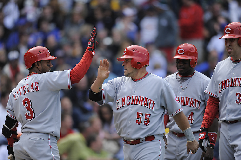 CHICAGO - APRIL 23:  Ramon Hernandez #55 of the Cincinnati Reds is greeted by teammate Willy Taveras #3 after scoring against the Chicago Cubs on April 23, 2009 at Wrigley Field in Chicago, Illinois.  The Reds defeated the Cubs 7-1.  (Photo by Ron Vesely)