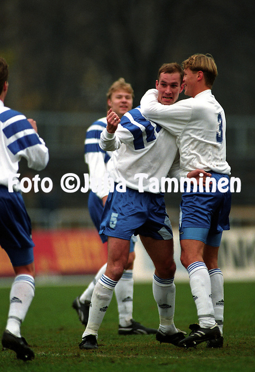 26.10.1994, Tallinn, Estonia..Friendly International match, Estonia v Finland..Anders Eriksson celebrates after scoring for Finland in 7-0 victory. Number 3 is Markku Kanerva..©Juha Tamminen