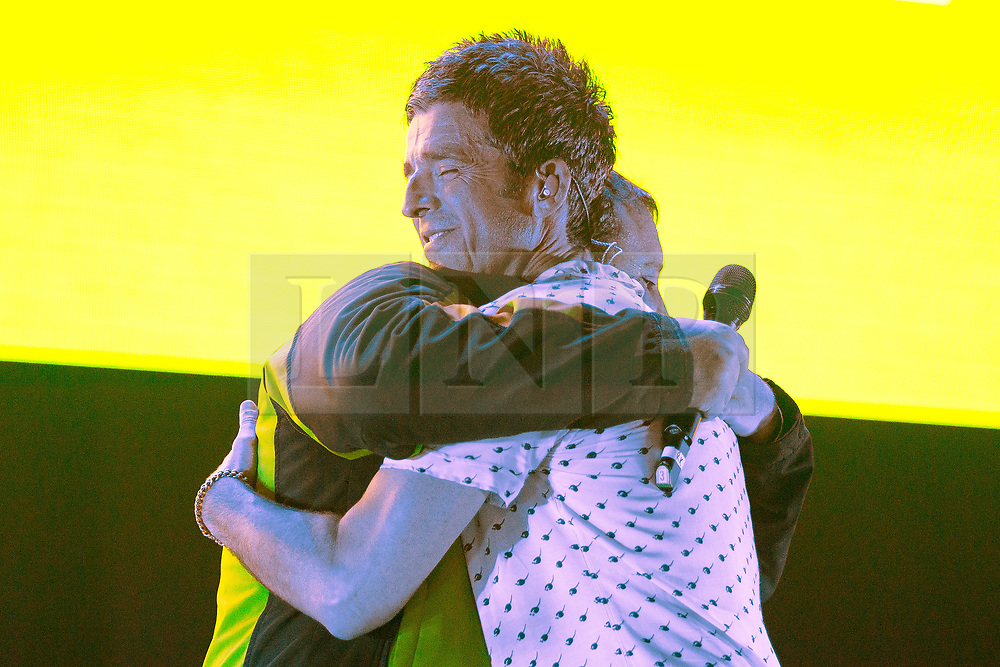 © Licensed to London News Pictures . 09/09/2017. Manchester , UK . PETER KAY and NOEL GALLAGHER hug on stage . Crowd at the front of the stage . We Are Manchester reopening charity concert at the Manchester Arena with performances by Manchester artists including  Noel Gallagher , Courteeners , Blossoms and the poet Tony Walsh . The Arena has been closed since 22nd May 2017 , after Salman Abedi's terrorist attack at an Ariana Grande concert killed 22 and injured 250 . Money raised will go towards the victims of the bombing . Photo credit: Joel Goodman/LNP