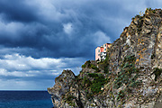 Remote house perched on seaside cliff, Cinque Terre, Liguria, Italy.