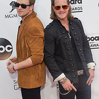 LAS VEGAS - MAY 18 : Florida Georgia Line members Brian Kelley (L) and Tyler Hubbard attend the 2014 Billboard Music Awards at the MGM Grand Garden Arena on May 18 , 2014 in Las Vegas.