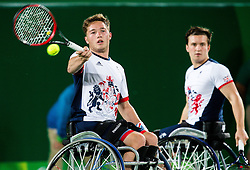 Gordon Reid and Alfie Hewett of the UK play against Stephane Houdet (out of frame) and Nicolas Peifer (out of frame) of France in the Tennis Men's Doubles Gold Medal Match during Day 8 of the Rio 2016 Summer Paralympics Games on September 15, 2016 in Olympic Tennis Centre, Rio de Janeiro, Brazil. Photo by Vid Ponikvar / Sportida