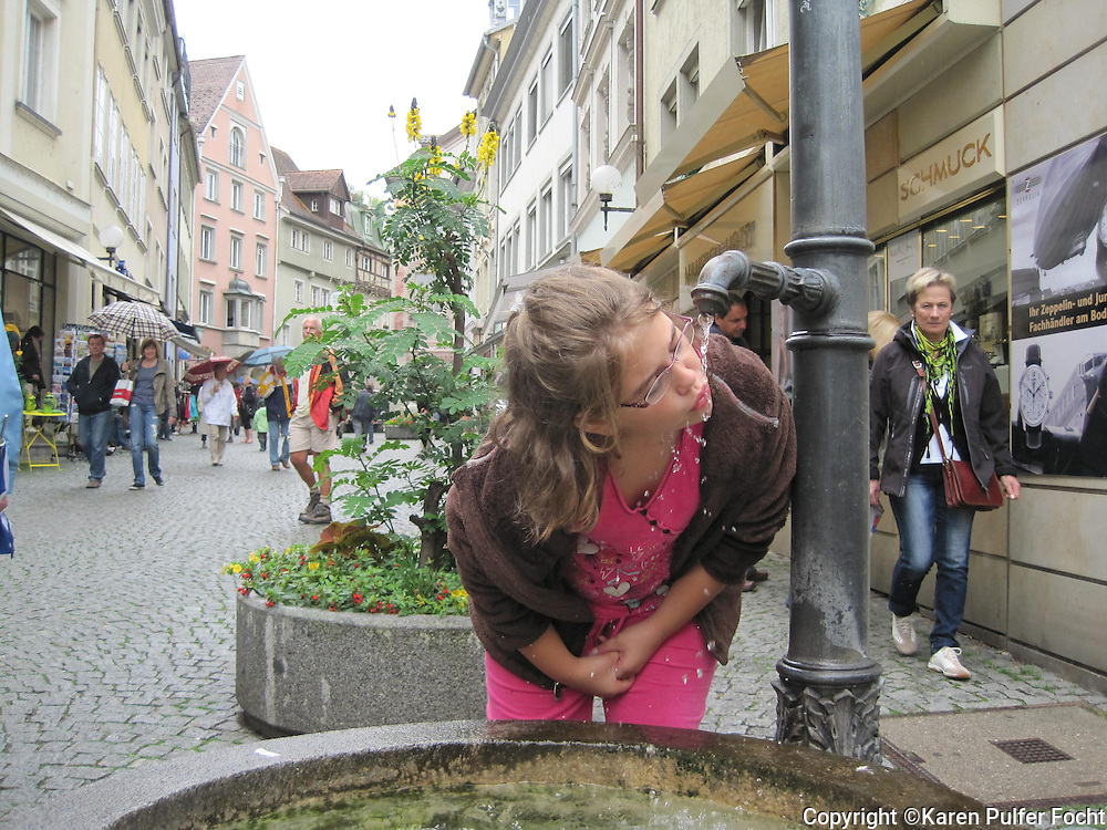 Elli Rose Focht enjoys a drink of water in Lindau, Germany, while she was on vacation.