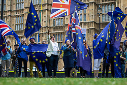 © Licensed to London News Pictures. 12/06/2018. London, UK. Anti-Brexit protesters wave EU flags outside Parliament as MPs debate the EU Withdrawal Bill. Photo credit: Rob Pinney/LNP