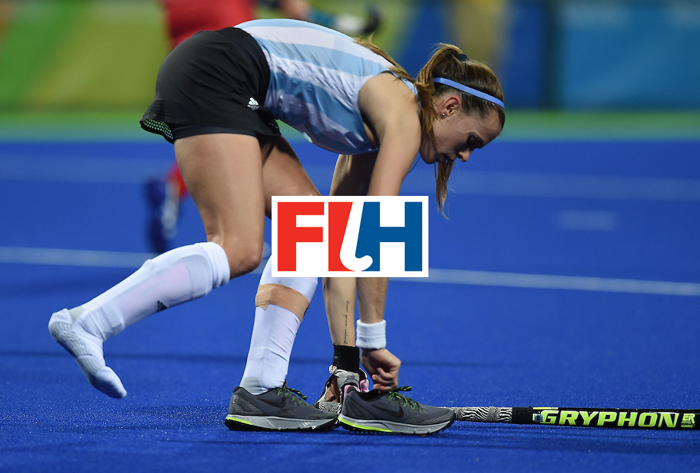 Argentina's Carla Rebecchi picks up her shoe during the women's field hockey Argentina vs USA match of the Rio 2016 Olympics Games at the Olympic Hockey Centre in Rio de Janeiro on August, 6 2016. / AFP / MANAN VATSYAYANA        (Photo credit should read MANAN VATSYAYANA/AFP/Getty Images)
