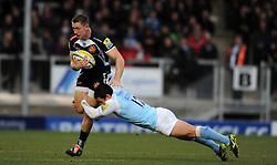 Exeter Chiefs Sam Hill is tackled by Newcastle Falcons Juan Pablo Socino  - Photo mandatory by-line: Harry Trump/JMP - Mobile: 07966 386802 - 14/02/15 - SPORT - Rugby - Aviva Premiership - Sandy Park, Exeter, England - Exeter Chiefs v Newcastle Falcons