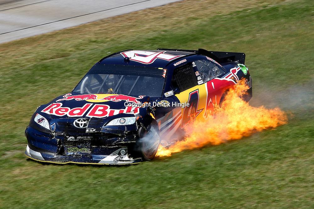 April 17, 2011; Talladega, AL, USA; NASCAR Sprint Cup Series driver Kasey Kahne (4) car catches fire during the Aarons 499 at Talladega Superspeedway.   Mandatory Credit: Derick E. Hingle