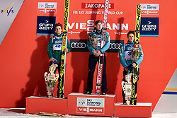 Poland, Zakopane - 2018 January 28: (L-R) Second Andreas Wellinger from Germany and winner Anze Semenic from Slovenia and third place holder Peter Prevc from Slovenia listen national anthem while awarding ceremony 18th World Cup Competition Men's HS140 Large Hill Individual during FIS Ski Jumping World Cup Zakopane 2017/2018 - Day 3 at Wielka Krokiew jumping hill on January 28, 2018 in Zakopane, Poland.<br /> <br /> Mandatory credit:<br /> Photo by &copy; Adam Nurkiewicz<br /> <br /> Adam Nurkiewicz declares that he has no rights to the image of people at the photographs of his authorship.<br /> <br /> Picture also available in RAW (NEF) or TIFF format on special request.<br /> <br /> Any editorial, commercial or promotional use requires written permission from the author of image.