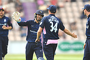 John Simpson and Tim Murtagh celebrate the wicket of Liam Dawson of Middlesex during the Royal London One Day Cup match between Hampshire County Cricket Club and Middlesex County Cricket Club at the Ageas Bowl, Southampton, United Kingdom on 23 April 2019.