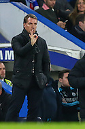 Brendan Rodgers, Manager of Liverpool, gives a positive sign to his players during the Capital One Cup Semi Final 2nd Leg match between Chelsea and Liverpool at Stamford Bridge, London, England on 27 January 2015. Photo by David Horn.