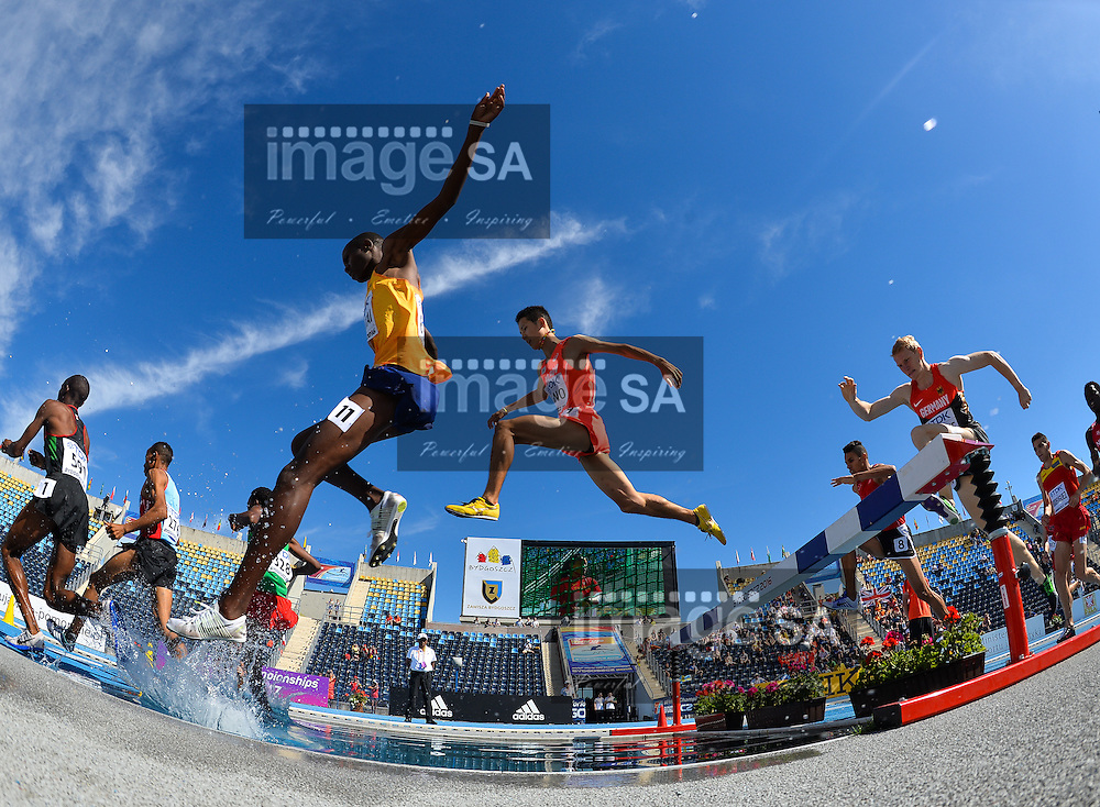 BYDGOSZCZ, POLAND - JULY 21: Taisei Ogino of Japan at the water jump in the mens 3000m steeplechase during day 3 of the IAAF World Junior Championships at Zawisza Stadium on July 21, 2016 in Bydgoszcz, Poland. (Photo by Roger Sedres/Gallo Images)
