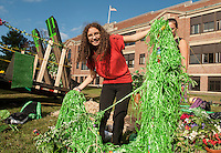 """Nickki Fain decorates the LHS Sophomore float """"Green"""" on Thursday afternoon to represent the United Nations Environmental Program for the """"Colors For A Cause"""" Homecoming theme  parade.     (Karen Bobotas/for the Laconia Daily Sun)"""