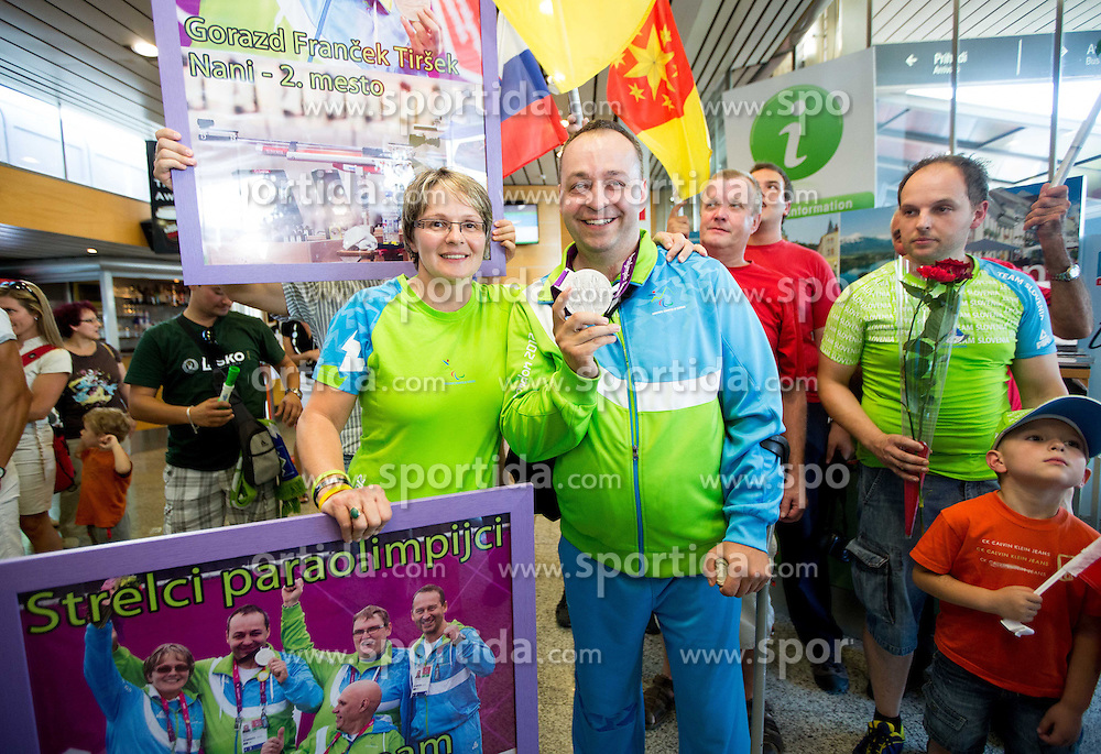 Coach Polona Sladic and Francek Gorazd Tirsek of Team Slovenia at arrival to Airport Joze Pucnik after the London 2012 Paralympic Games on September 10, 2012, in Brnik, Slovenia. (Photo by Vid Ponikvar / Sportida.com)