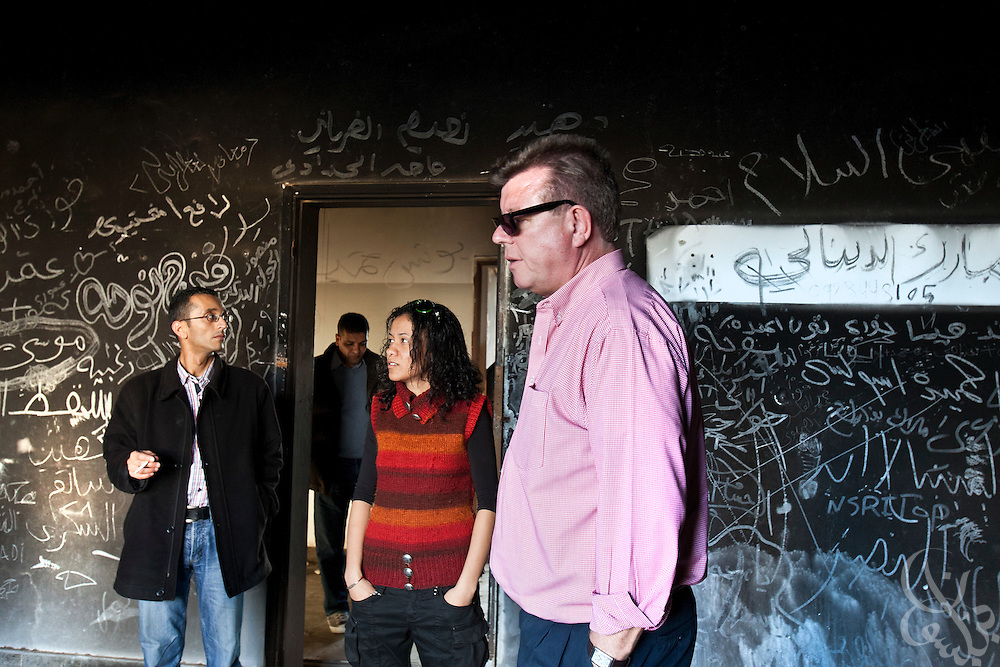 Dr. Ronald Meinardus (l), Regional Director of the Friedrich Naumann Foundation for Liberty (FNF) tours the grounds of a destroyed military base in  Benghazi, Libya December 16, 2011. Before it was overrun in the first days of the revolution, the base once stood as the city's central garrison for troops and authorities loyal to former leader Muammar Gaddafi. (Photo by Scott Nelson, for Der Spiegel)
