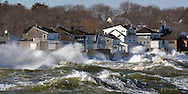 (SCITUATE MA 012416)-The surf hits the sea wall and properties along Turner Rd. Herald photo Chris Christo