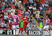 Barnet defender, Bondz N'Gala beats Jay Simpson to a high ball during the Sky Bet League 2 match between Leyton Orient and Barnet at the Matchroom Stadium, London, England on 8 August 2015. Photo by Bennett Dean.