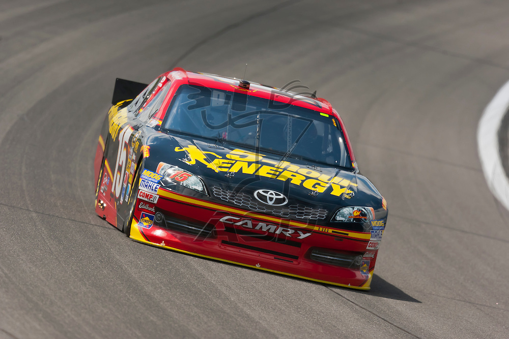 KANSAS CITY, KS - APR 20, 2012:  Clint Bowyer (15) brings his car through the turns during a practice session for the STP 400 at the Kansas Speedway in Kansas City, KS.