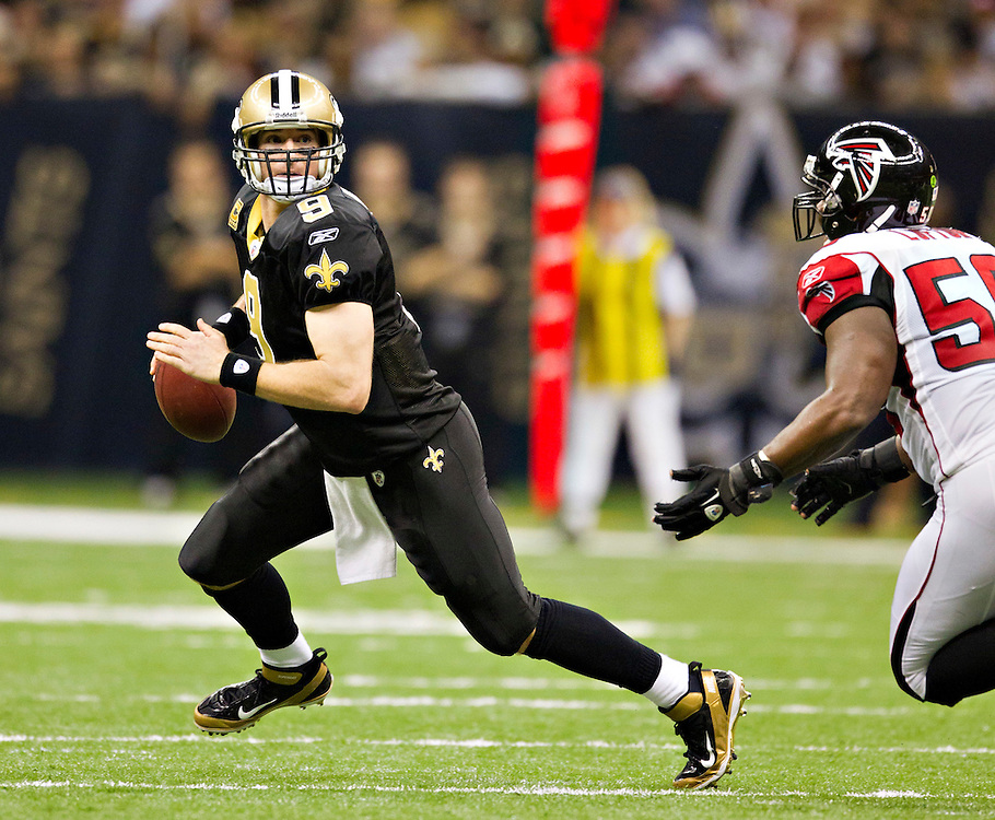 NEW ORLEANS, LA - DECEMBER 26:   Drew Brees #9 of the New Orleans Saints tries to avoid the rush against the Atlanta Falcons at Mercedes-Benz Superdome on December 26, 2011 in New Orleans, Louisiana.  The Saints defeated the Falcons 45-16.  (Photo by Wesley Hitt/Getty Images) *** Local Caption *** Drew Brees