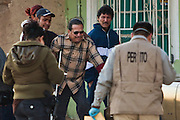 Police hold back the father of three boys killed in a drug related shootout after he arrives on the scene in a slum in Juarez, Mexico January 14, 2009. The shooting, believed linked to the ongoing drug war which has already claimed more than 40 people since the start of  the year. More than 1600 people were killed in Juarez in 2008, making Juarez the most violent city in Mexico.    (Photo by Richard Ellis)