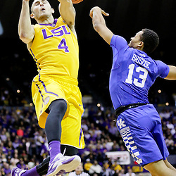 Jan 5, 2016; Baton Rouge, LA, USA; LSU Tigers guard Keith Hornsby (4) loses the ball as Kentucky Wildcats guard Isaiah Briscoe (13) defends during the first half of a game at the Pete Maravich Assembly Center. Mandatory Credit: Derick E. Hingle-USA TODAY Sports