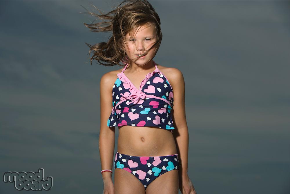 Little Girl Standing on a Beach