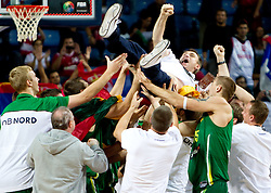 Players of Lituania celebrate with Head coach  of Lithuania Kestutis Kemzura after winning the third-place basketball match between National teams of Serbia and Lithuania at 2010 FIBA World Championships on September 12, 2010 at the Sinan Erdem Dome in Istanbul, Turkey. Lithuania defeated Serbia 99 - 88 and win placed third.  (Photo By Vid Ponikvar / Sportida.com)