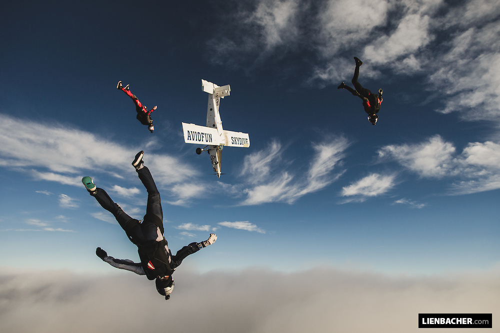 Damijan Cehner flies his Pilatus in formation with the Red Bull Skydive Team